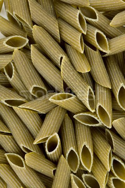 Green colored penne pasta Stock photo © karandaev