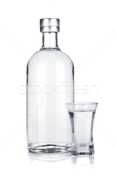 Bottle of vodka and shot glass Stock photo © karandaev