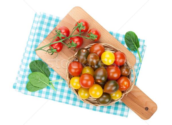 Colorful cherry tomatoes on cutting board Stock photo © karandaev