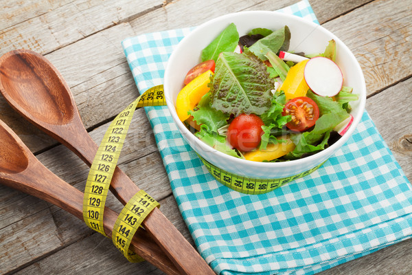 Fresh healthy salad and kitchen utensil Stock photo © karandaev
