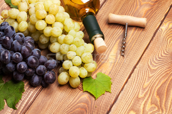 White wine bottle and bunch of grapes Stock photo © karandaev