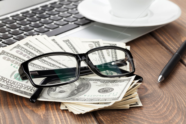 Office table with pc, coffee cup and glasses over money cash Stock photo © karandaev
