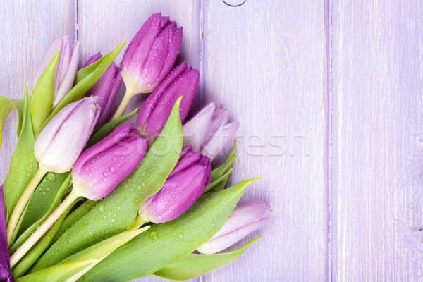 Stock photo: Purple tulips over wooden table