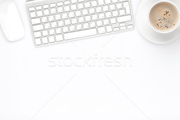 Office desk table with computer and coffee cup Stock photo © karandaev