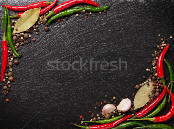 Chili pepper, peppercorn, garlic and bay leaves Stock photo © karandaev