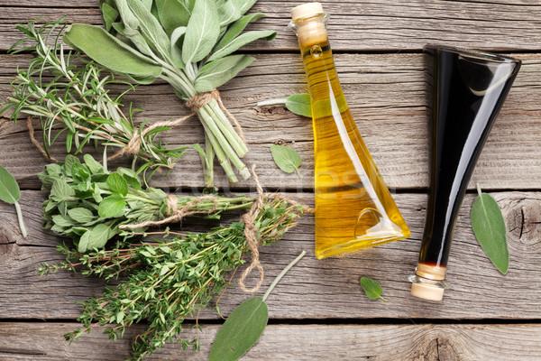Friss kert gyógynövények fűszerek fa asztal felső Stock fotó © karandaev