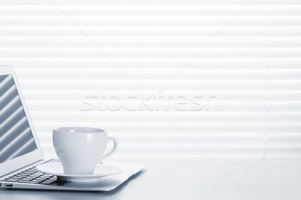 Office workplace with with laptop and coffee cup Stock photo © karandaev