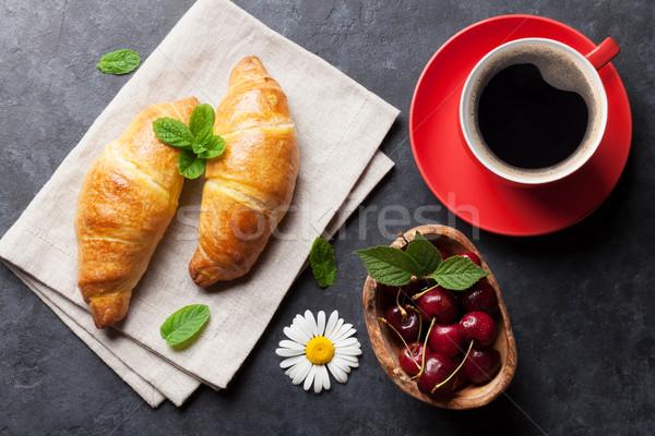 Friss croissantok cseresznye bogyók kávéscsésze kő Stock fotó © karandaev
