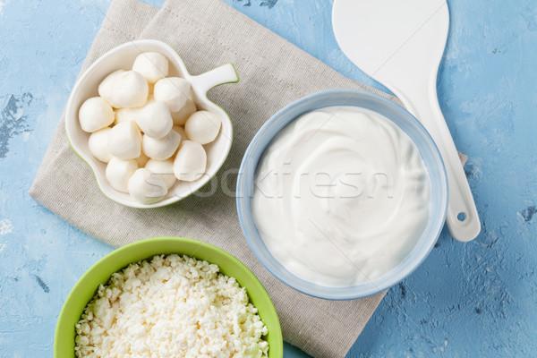 Tejtermékek kő asztal tejföl sajt joghurt Stock fotó © karandaev