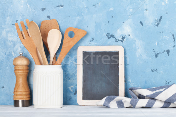 Kitchen utensils and chalkboard Stock photo © karandaev