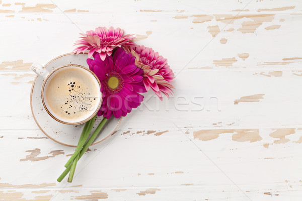 Coffee cup and gerbera flowers Stock photo © karandaev