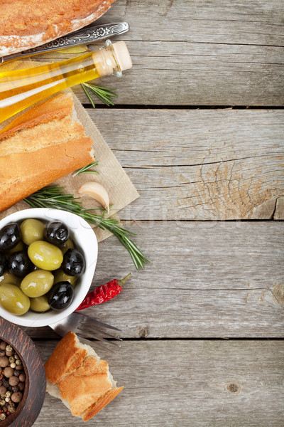 Italian food appetizer of olives, bread, olive oil and balsamic  Stock photo © karandaev