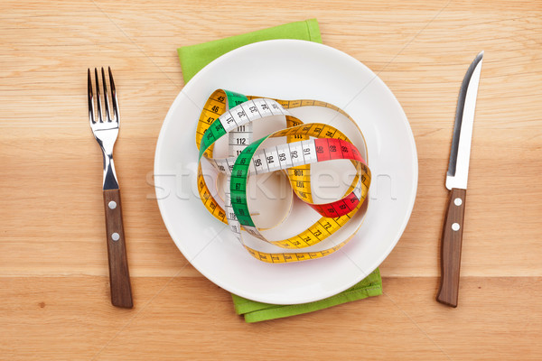 Plate with measure tape, knife and fork. Diet food Stock photo © karandaev