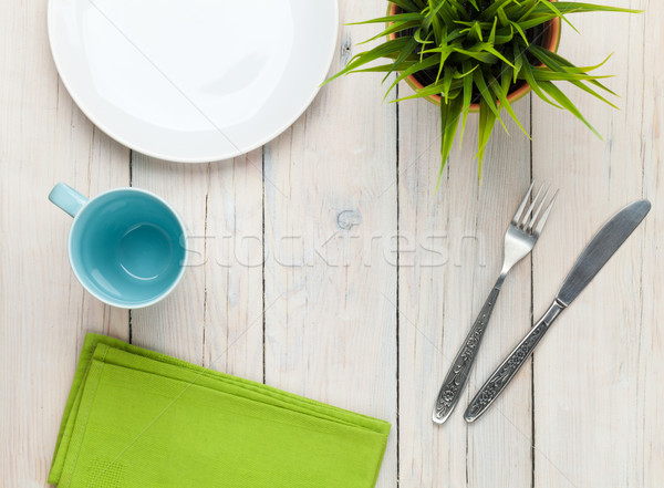 Empty plate, cup and silverware over white wooden table backgrou Stock photo © karandaev