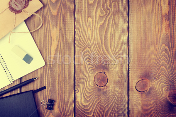 Office table with notepad, vintage envelope and supplies Stock photo © karandaev