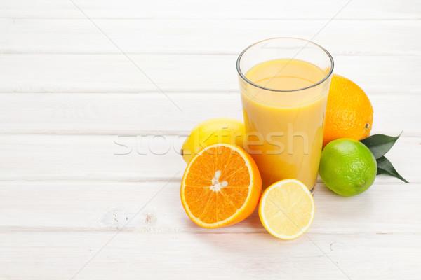 Orange juice and citrus fruits Stock photo © karandaev
