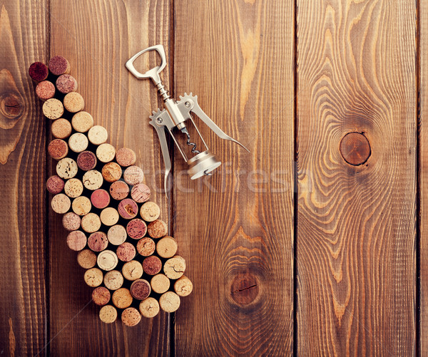 Wine bottle shaped corks and corkscrew Stock photo © karandaev