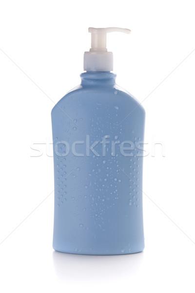 Kék sampon üveg vízcseppek izolált fehér Stock fotó © karandaev