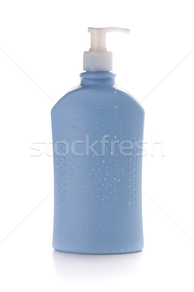 Blu shampoo bottiglia gocce d'acqua isolato bianco Foto d'archivio © karandaev
