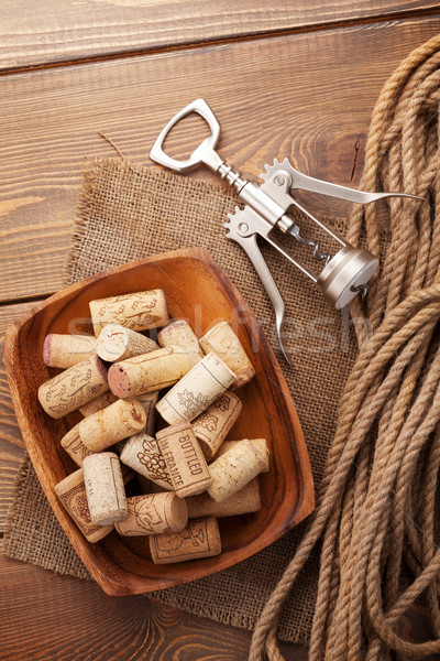 Bowl with wine corks and corkscrew Stock photo © karandaev
