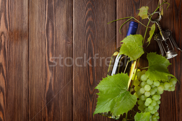 Bunch of grapes, white wine bottle and corkscrew Stock photo © karandaev