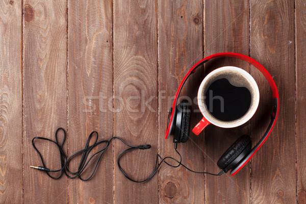 Headphones and coffee cup Stock photo © karandaev