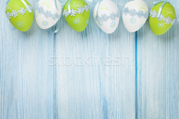 Húsvéti tojások kék fa asztal felső kilátás copy space Stock fotó © karandaev