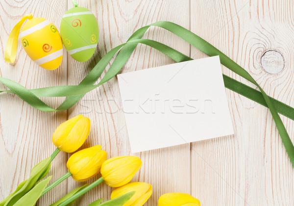 Easter eggs tulipani scheda vuota biglietto d'auguri tavolo in legno top Foto d'archivio © karandaev