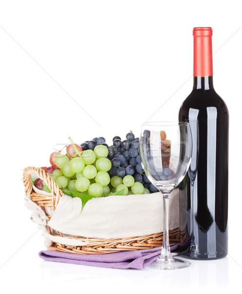 Red wine bottle, glass and grapes Stock photo © karandaev