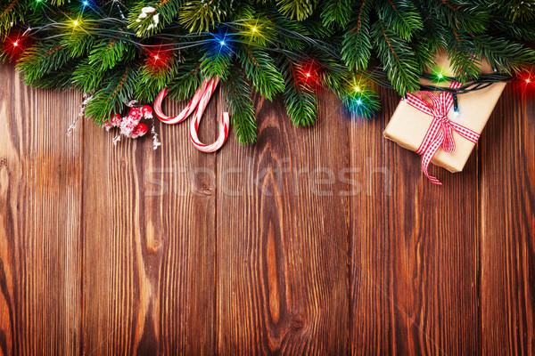 Fenyőfa ág karácsony fények ajándék doboz cukorka Stock fotó © karandaev
