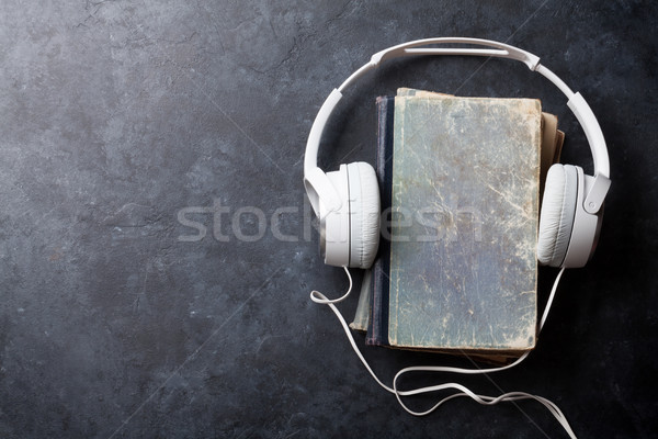 Audio libro cuffie vecchio libri pietra Foto d'archivio © karandaev