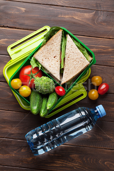 Lunch box with vegetables and sandwich Stock photo © karandaev
