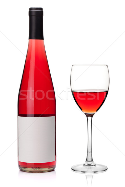 Rose wine in a glass and bottle Stock photo © karandaev