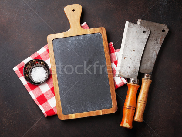 Butcher. Vintage meat knives and spices Stock photo © karandaev