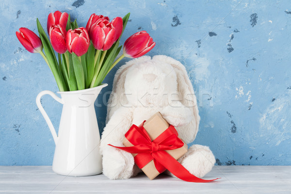 Red tulip flowers and easter rabbit toy Stock photo © karandaev