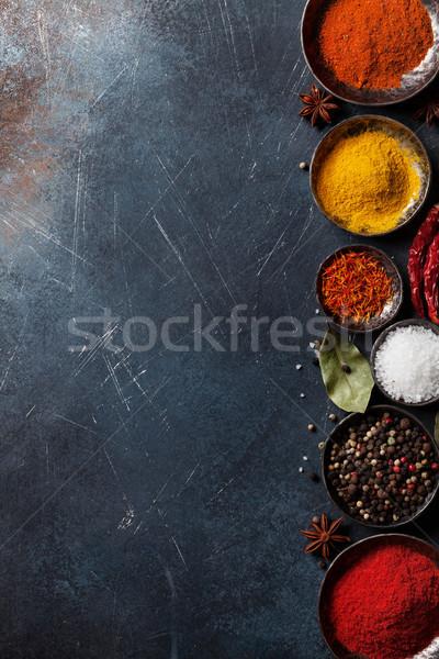 Colorful spices on stone table Stock photo © karandaev