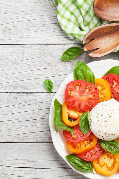 Caprese salatası domates fesleğen mozzarella üst görmek Stok fotoğraf © karandaev