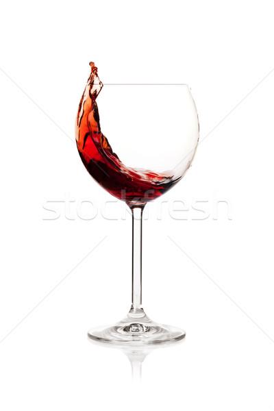 Splashing red wine in a glass Stock photo © karandaev