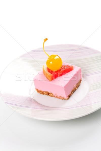 Pink cheesecake with maraschino cherry and grapefruit slice Stock photo © karandaev