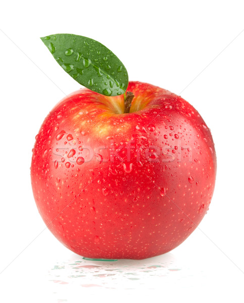 Stock photo: A ripe red apple with green leaf