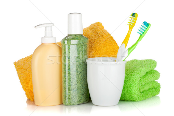 Toothbrushes, cosmetics bottles and two towels Stock photo © karandaev