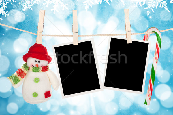Blank photo frames and snowman hanging on the clothesline Stock photo © karandaev