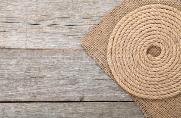 Ship rope on wood and burlap Stock photo © karandaev