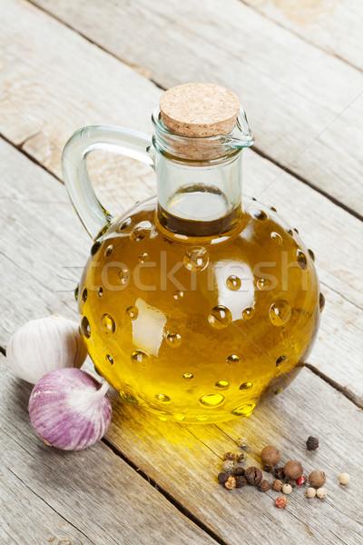 Olive oil bottle with spices Stock photo © karandaev