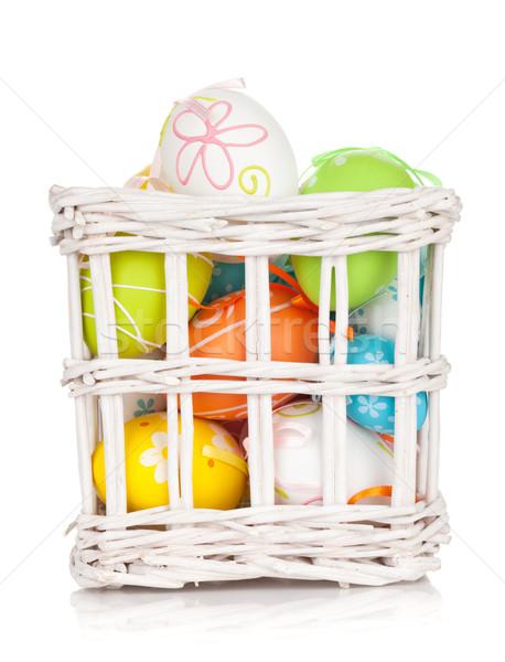 Colorido huevos de Pascua cesta aislado blanco primavera Foto stock © karandaev