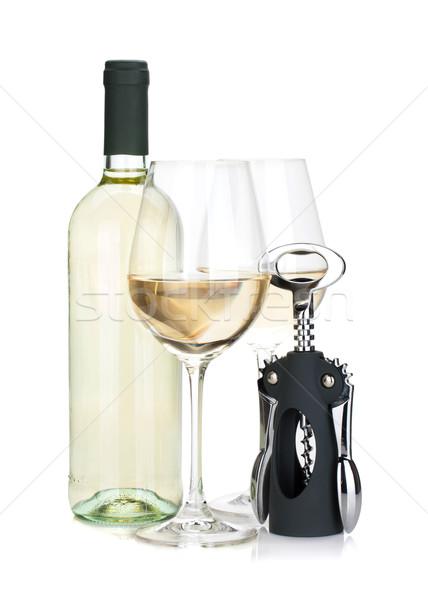 White wine bottle, two glasses and corkscrew Stock photo © karandaev