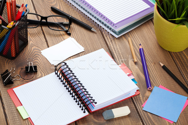 Office table with blank notepad and supplies Stock photo © karandaev