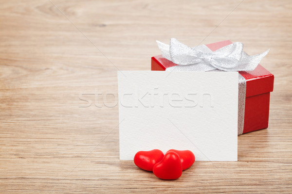 Blank valentines greeting card, gift box and red candy hearts Stock photo © karandaev