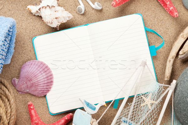Travel and vacation notepad with items over sand Stock photo © karandaev
