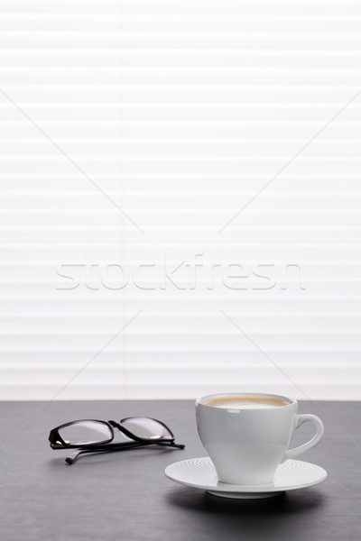 Office desk workplace with coffee and glasses Stock photo © karandaev